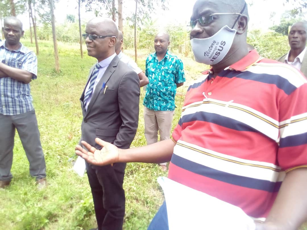 Ibanda CAO Kweyamba Ruhemba interacting with the Contractor at the site handover. Kihani Health Centre 11 will be upgraded to Health Centre 111. Mr. Ruhemba warned the Contractor of Shoddy work.Photo by Sylas Byaruhanga